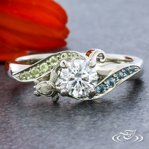 This White Gold Ring Features A Round Diamond Surrounded By Aquamarine And Peridot Bead Set Waves Turtle Filigree Curl Are Nestled In Sea Of