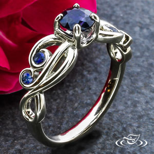 SAPPHIRE AND SWIRL ENGAGEMENT RING