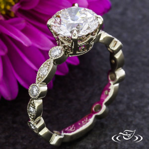 MARQUISE DIAMOND AND BEZEL DIAMOND ENGAGEMENT RING