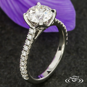 PIERCED PRONG ENGAGEMENT RING
