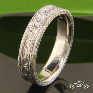 Hand engraved diamond wedding band.
