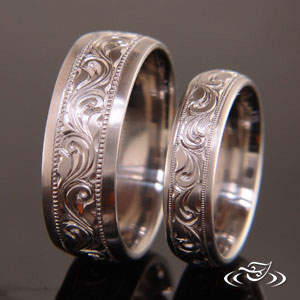 Hand engraved wedding band set with deep scroll engraving.