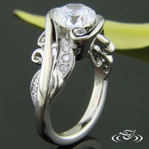PLATINUM ORGANIC WRAP STYLE MOUNTING WITH ROUND DIAMONDS SET THROUGHOUT