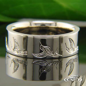 Hand engraved wedding band with Hummingbird motif.