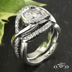 Fire Ice Diamond Fishtail Set Down Opposite Arms Of Wrap Round Brilliant Cut Accent Diamonds Pierced Twist Design On Shoulders Tapers To Soft Flat